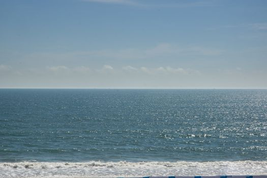 The sea and the sky, the white waves, colorful