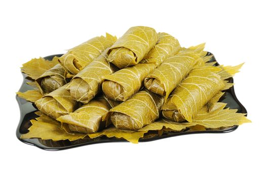 Dolma on a black plate. Isolated on white background.