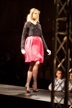 PRAGUE-SEPTEMBER 24: A model walks the runway during the 2011 au