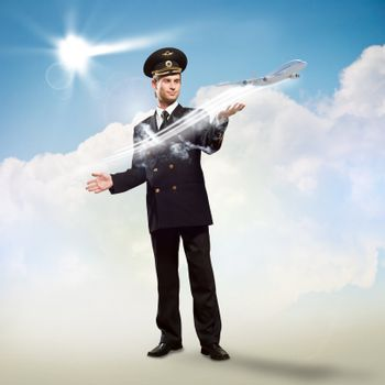 pilot in the form of extending a hand to a flying airplane with sky, clouds and sun