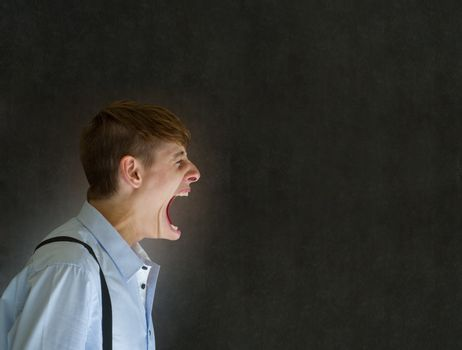 Angry big mouth man shouting on blackboard background
