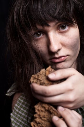 beggar woman with a piece of bread