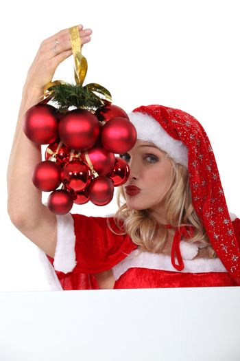 Woman dressed in provocative Christmas outfit