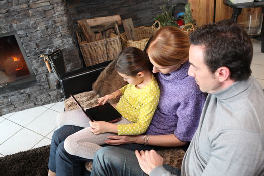 Young family watching film on laptop