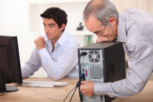 Grandfather installing computer