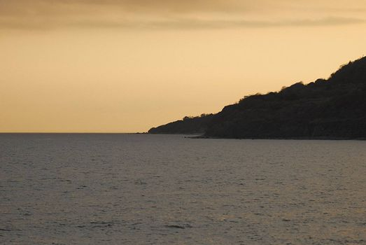 scilouetted cliffs going into english chanel at sun set