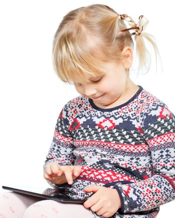 Child playing with a tablet computer
