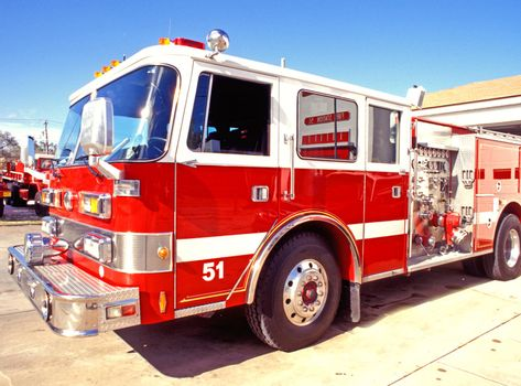 Red fire engine at the fire station.
