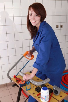 Woman sawing tube