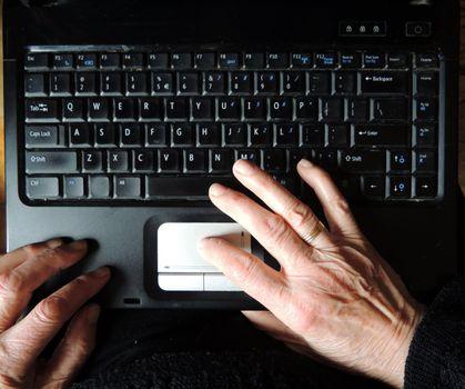 senior woman using laptop