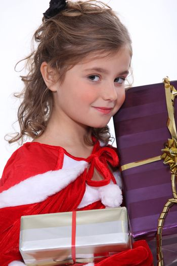 Pretty girl holding her Christmas presents