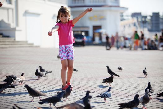 Child feeding doves