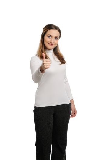 Beautiful young woman thumb up. Isolated on white background.