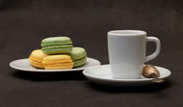 cup coffee expresso and macaroon