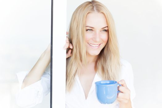 Gorgeous woman with coffee cup