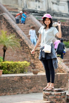 Asian woman enjoying at Buddhist temple