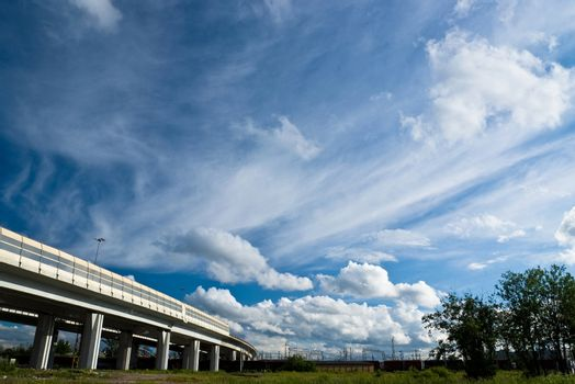 urban landscape with highway and clouds