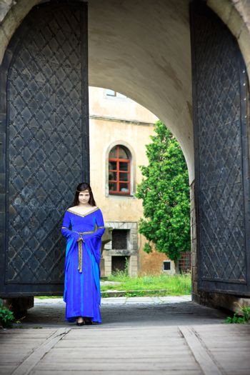 medieval girl on street of old town