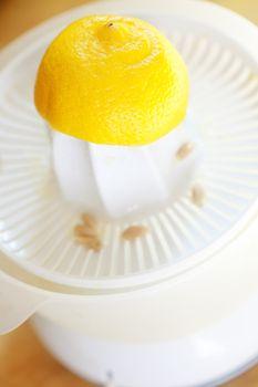 Lemon in juicer