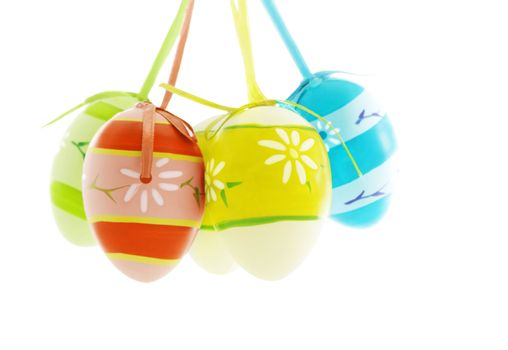 Colorful Easter eggs over white background