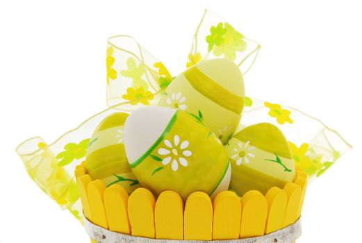 Easter eggs in the basket isolated on white background
