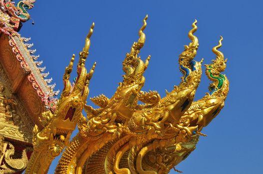 four heads of golden serpent sculpture