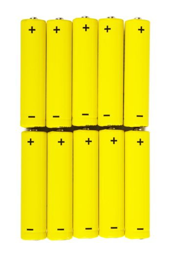 A row of yellow batteries isolated over white background
