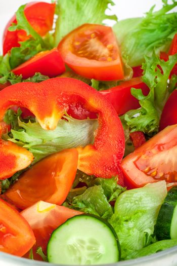 Fresh salad with tomatos cucumbers and peppers