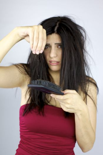 Hair loss problem sad and terryfied woman