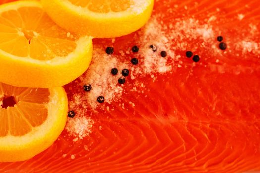 Salted salmon with lemon and pepper closeup
