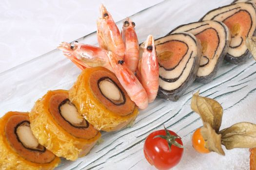 Stuffed fish and prawns with vegetables on plate