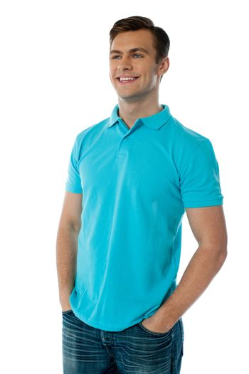Relaxed handsome young guy looking away while posing with hands in his pocket