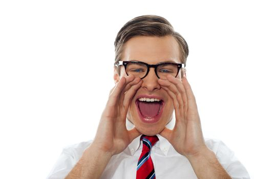Excited young man excited shouting with glasses on against white background