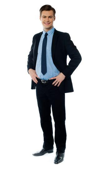 Portrait of a stylish businessman posing with hands on his waist