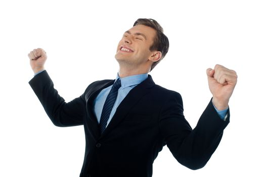 Excited successful businessman looking up against white background