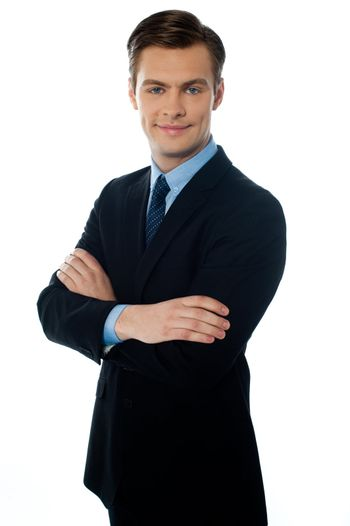 Businessman wearing a smart suit and tie on white background
