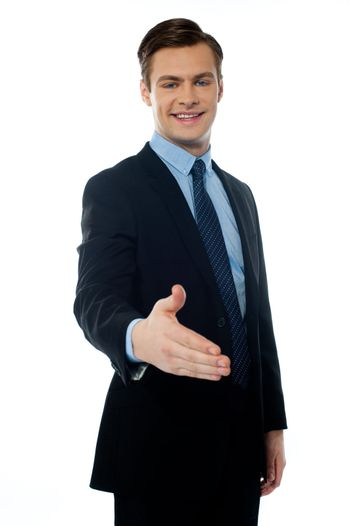 Successful young businessman offering handshake