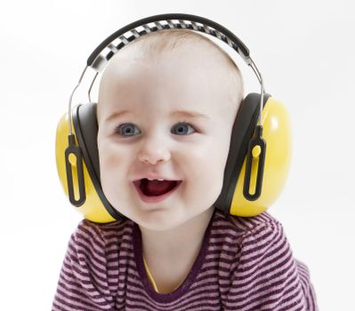young child laughing with yellow ear protector