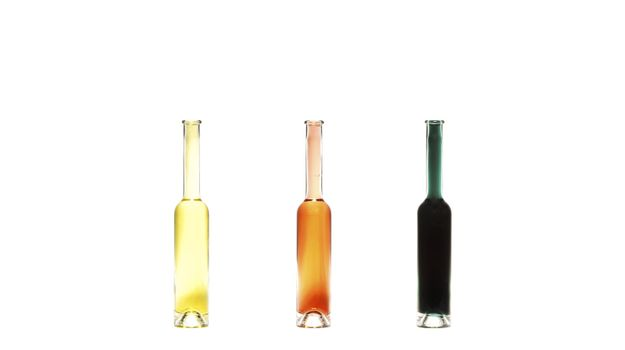 three tiny bottle on white background with various fluid