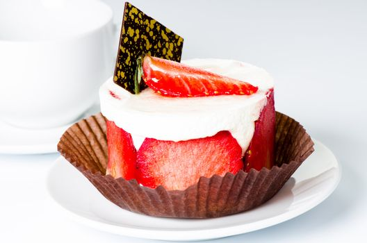 Strawberry cake on cup background