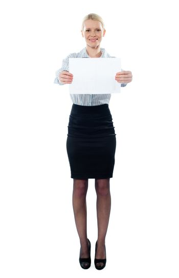 Caucasian female executive holding a blank billboard isolated on white background