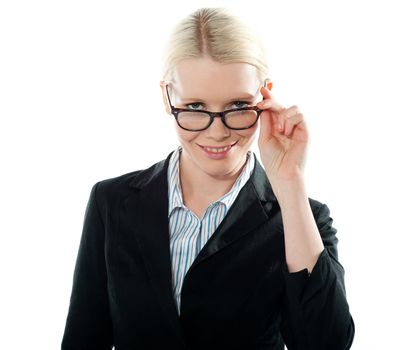 Businesswoman holding her glasses and taking a closer look from within