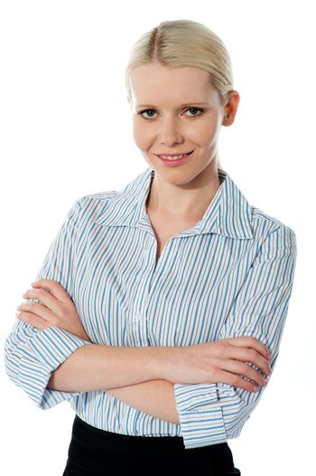 Glamourous female executive posing with folded arms isolated over white background