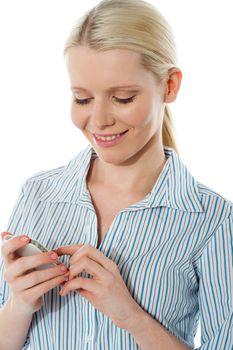 Stylish corporate female texting on phone isolated over white background