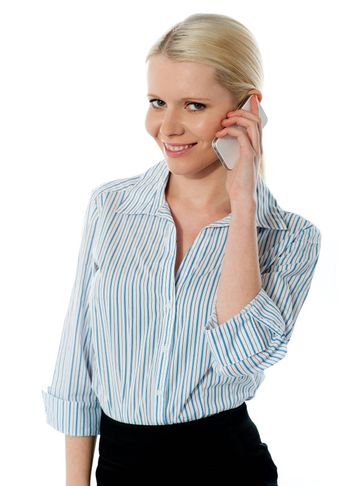 Businesswoman talking on phone and smiling at camera
