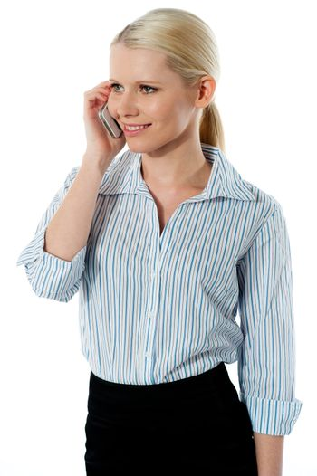 Attractive corporate woman talking business deal