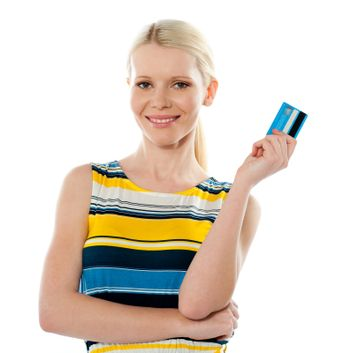 Smiling young girl holding debit-card isolated over white background