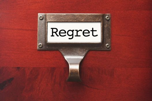 Lustrous Wooden Cabinet with Regret File Label