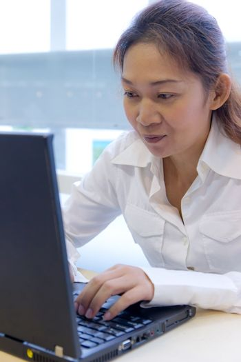 asian woman with laptop notebook
