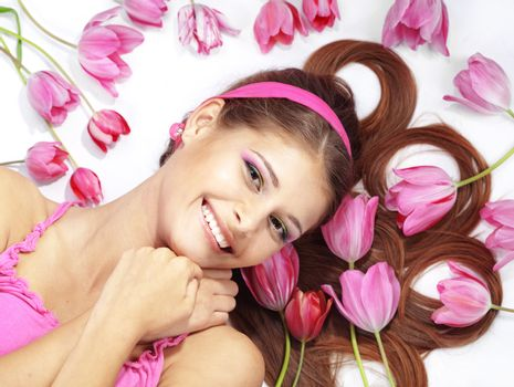 Beautiful girl with tulips